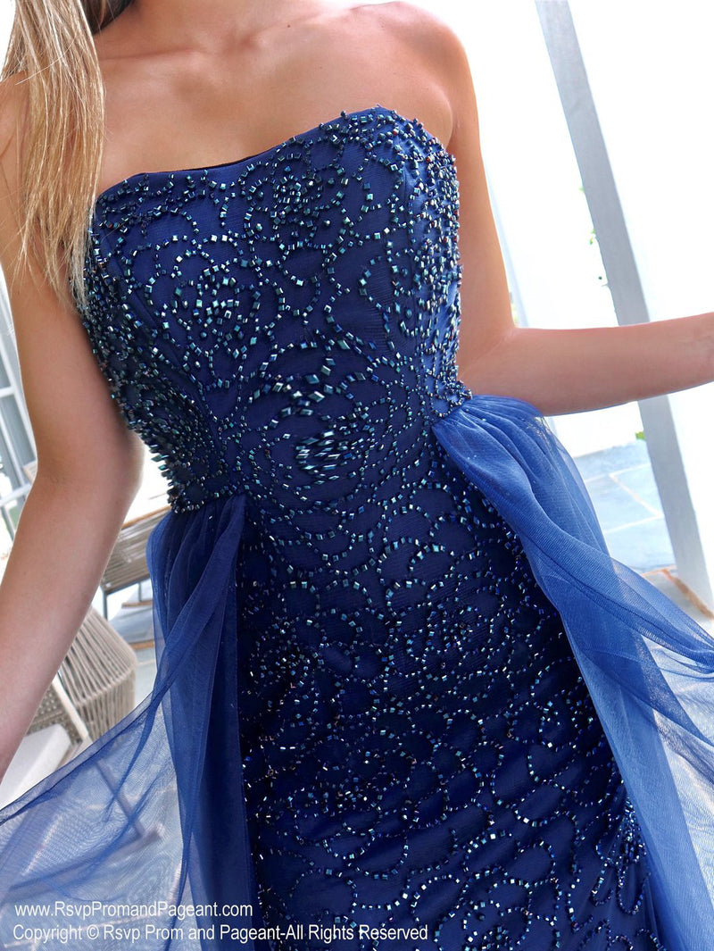 Closeup of Model in this absolutely stunning strapless mermaid dress featuring navy beading all over and a soft flowing tulle overlay skirt! And it's at Rsvp Prom and Pageant, your source for the HOTTEST Prom and Pageant Dresses and exclusive evening gowns and located in Atlanta, Georgia!