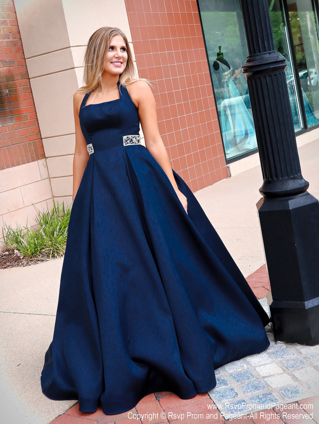 Model in the prettiest ball gown you've ever seen with its halter neckline and beautifully detailed back straps! And it's at Rsvp Prom and Pageant, your source for the HOTTEST Prom and Pageant Dresses and Exclusive Evening Gowns and located in Atlanta, Georgia!