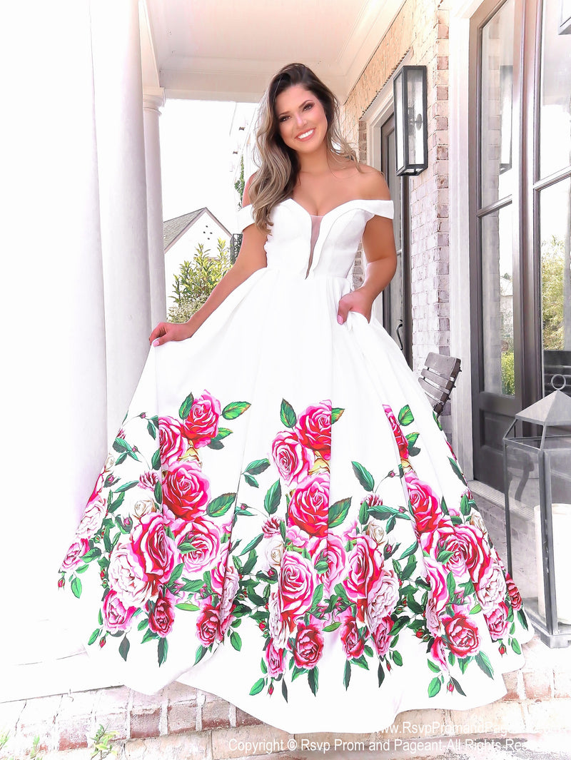 Model in this gorgeous white off the shoulder ball gown and a full floral skirt with pockets! And it's at Rsvp Prom and Pageant, your source for the HOTTEST Prom and Pageant Dresses and exclusive evening gowns and located in Atlanta, Georgia!