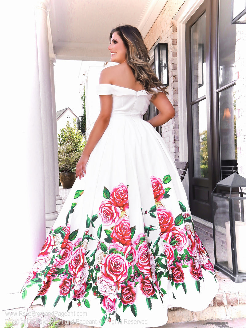 Back of model in this gorgeous white off the shoulder ball gown and a full floral skirt with pockets! And it's at Rsvp Prom and Pageant, your source for the HOTTEST Prom and Pageant Dresses and exclusive evening gowns and located in Atlanta, Georgia!
