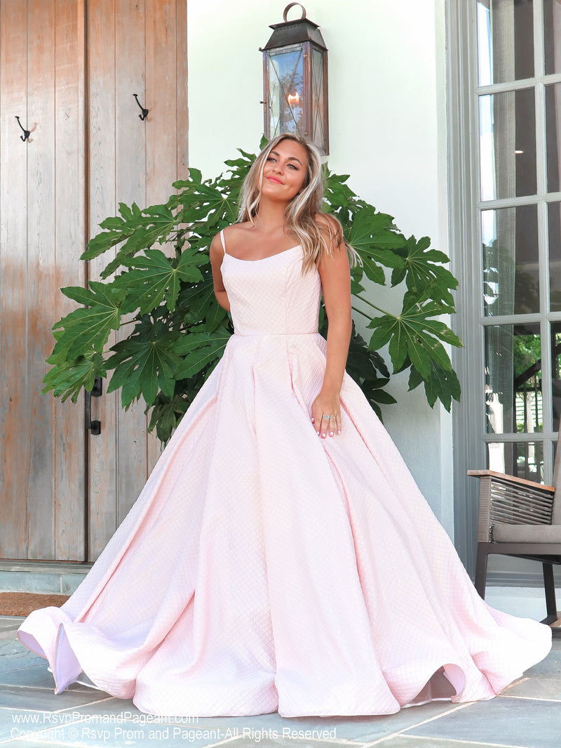 Front of Model in this absolutely sweet and stunning ball gown perfect for pictures and dancing the night away! And it's at Rsvp Prom and Pageant, your source for the HOTTEST Prom and Pageant Dresses and exclusive evening gowns and located in Atlanta, Georgia!