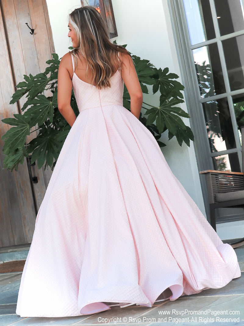Back of Model in this absolutely sweet and stunning ball gown perfect for pictures and dancing the night away! And it's at Rsvp Prom and Pageant, your source for the HOTTEST Prom and Pageant Dresses and exclusive evening gowns and located in Atlanta, Georgia!