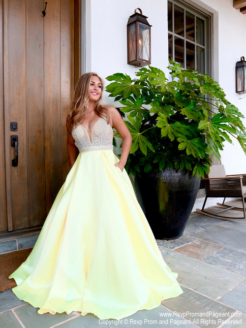 Model in a yellow ball gown with its beaded bodice and pockets! Perfect for prom, pageant or sweet sixteen! And it's at Rsvp Prom and Pageant, your source for the HOTTEST Prom and Pageant Dresses and exclusive evening gowns and located in Atlanta, Georgia!