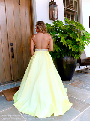 Back of Model in a yellow ball gown with its beaded bodice and pockets! Perfect for prom, pageant or sweet sixteen! And it's at Rsvp Prom and Pageant, your source for the HOTTEST Prom and Pageant Dresses and exclusive evening gowns and located in Atlanta, Georgia!
