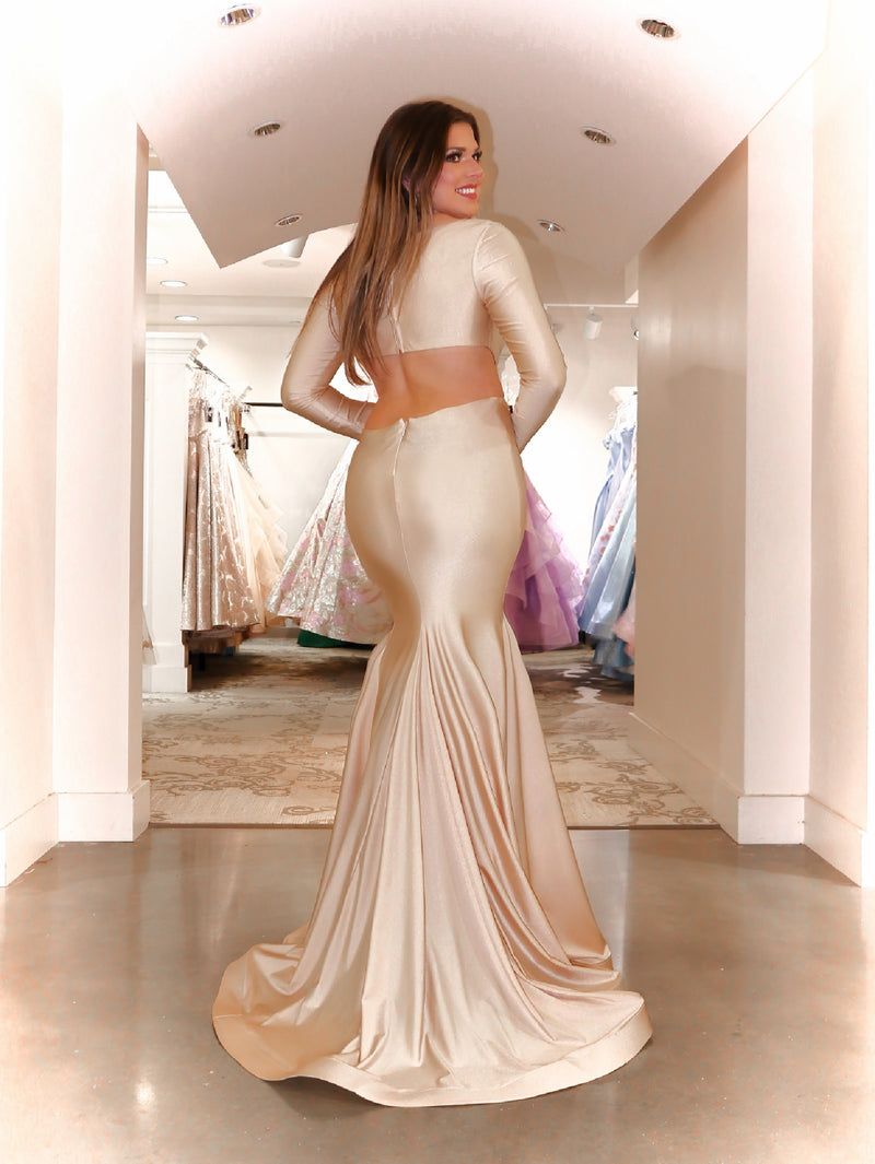 Back of Model in this gorgeous formfitted dress featuring an open back, long sleeves and a v neckline! And it's at Rsvp Prom and Pageant, your source for the HOTTEST Prom and Pageant Dresses and exclusive evening gowns and located in Atlanta, Georgia!