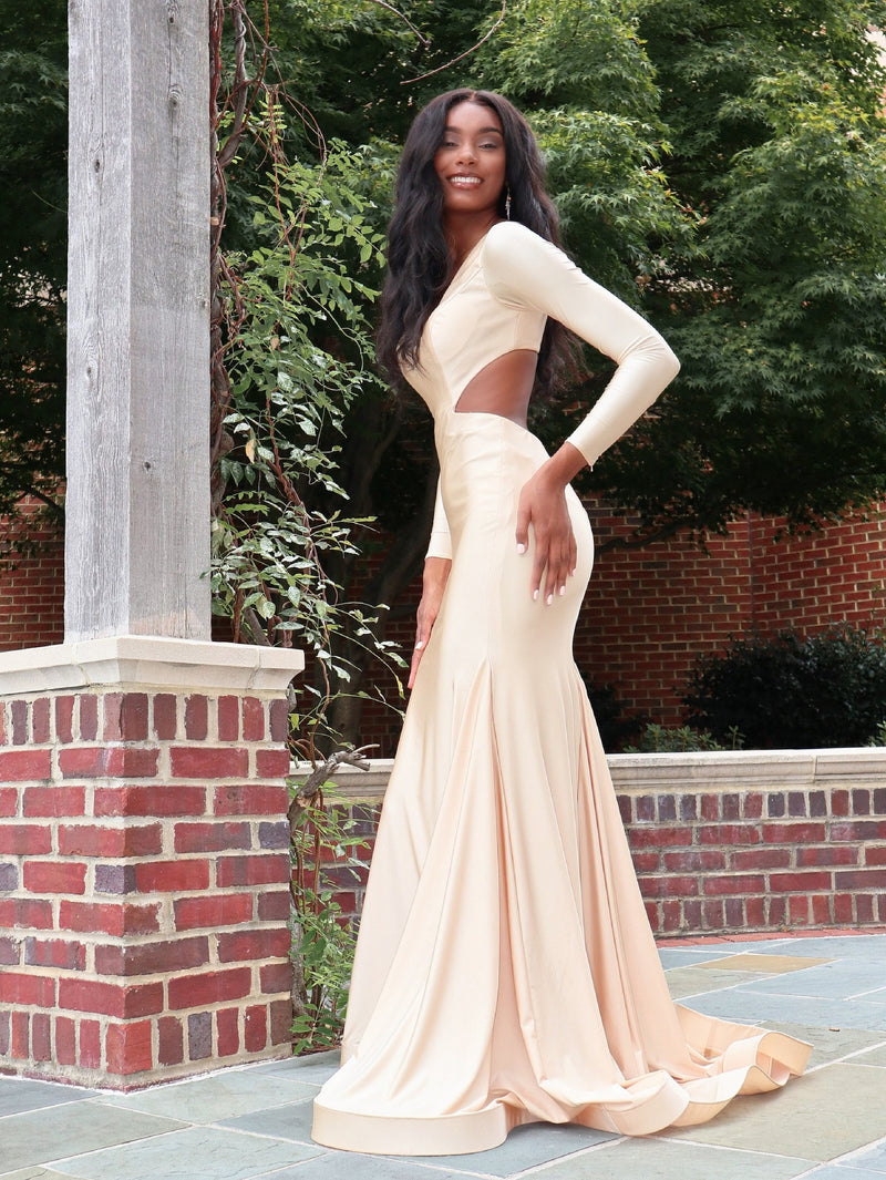 Model in this gorgeous formfitted dress featuring an open back, long sleeves and a v neckline! And it's at Rsvp Prom and Pageant, your source for the HOTTEST Prom and Pageant Dresses and exclusive evening gowns and located in Atlanta, Georgia!