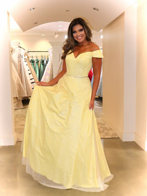 Model sparkling under the lights in this pretty yellow, off-the-shoulder A-line Prom Dress! And its at RSVP Prom and Pageant, your source for the HOTTEST Prom and Pageant Dresses and Exclusive Evening Gowns and located in Atlanta, Georgia!