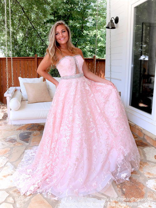 Model in a absolutely stunning lace ball gown features a strapless sweetheart neckline and a cut out in the bodice! And it's at Rsvp Prom and Pageant, your source for the HOTTEST Prom and Pageant Dresses, located in Atlanta, Georgia!