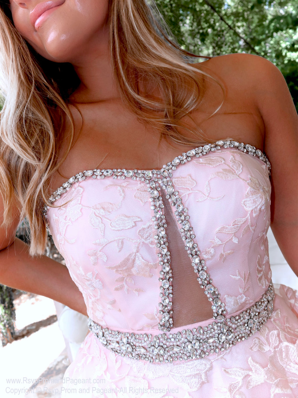 Closeup of model in absolutely stunning lace ball gown features a strapless sweetheart neckline and a cut out in the bodice! And it's at Rsvp Prom and Pageant, your source for the HOTTEST Prom and Pageant Dresses, located in Atlanta, Georgia!
