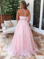 Back of model in a absolutely stunning lace ball gown features a strapless sweetheart neckline and a cut out in the bodice! And it's at Rsvp Prom and Pageant, your source for the HOTTEST Prom and Pageant Dresses, located in Atlanta, Georgia!
