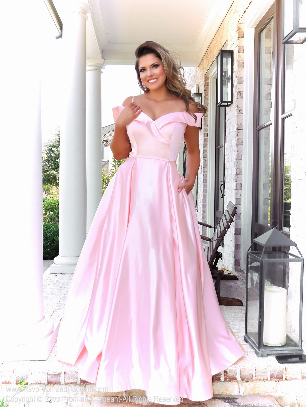 Model in a gorgeous satin ball gown featuring off the shoulder straps, a sweetheart neckline and full flowing skirt with pockets! And it's at Rsvp Prom and Pageant, your source for the HOTTEST Prom and Pageant Dresses and exclusive evening gowns and located in Atlanta, Georgia!