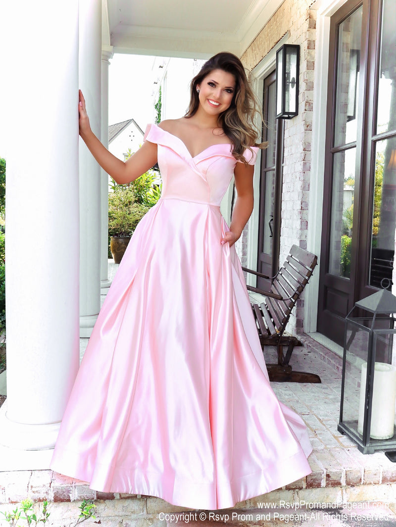 Brunette Model in a gorgeous satin ball gown featuring off the shoulder straps, a sweetheart neckline and full flowing skirt with pockets! And it's at Rsvp Prom and Pageant, your source for the HOTTEST Prom and Pageant Dresses and exclusive evening gowns and located in Atlanta, Georgia!