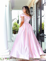Back of Model in a gorgeous satin ball gown featuring off the shoulder straps, a sweetheart neckline and full flowing skirt with pockets! And it's at Rsvp Prom and Pageant, your source for the HOTTEST Prom and Pageant Dresses and exclusive evening gowns and located in Atlanta, Georgia!