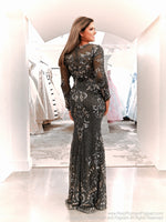 Back of Model in this beautiful long sleeved sequin Prom Dress. And it's at RSVP Prom and Pageant, your source for the HOTTEST Prom and Pageant Dresses and Exclusive Evening Gowns and located in Atlanta, Georgia!