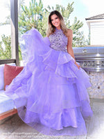 Model in a beautiful lilac gown with its intricately laced high neckline bodice, low scooped back and its voluminous asymmetrically layered and tiered tulle skirt. This is THE dress and it's at Rsvp Prom and Pageant, your source for the HOTTEST Prom and Pageant dresses and Exclusive Evening Gowns and located in Atlanta, Georgia!