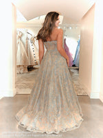Back of model in this amazing gold ball gown detailed with gorgeous gold applique and a sexy sheer sweetheart bodice! And it's at Rsvp Prom and Pageant, your source for the HOTTEST prom and pageant dresses and exclusive evening gowns and located in Atlanta, Georgia!