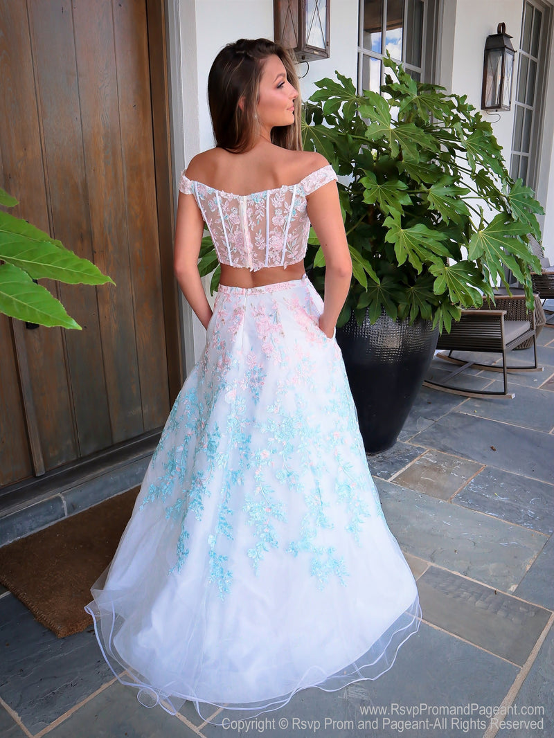 back of Model in a gorgeous two piece prom dress features off the shoulder straps, a sweetheart neckline and a full A-line skirt! And it's at Rsvp Prom and Pageant, your source for the HOTTEST Prom and Pageant Dresses and exclusive evening gowns and located in Atlanta, Georgia!