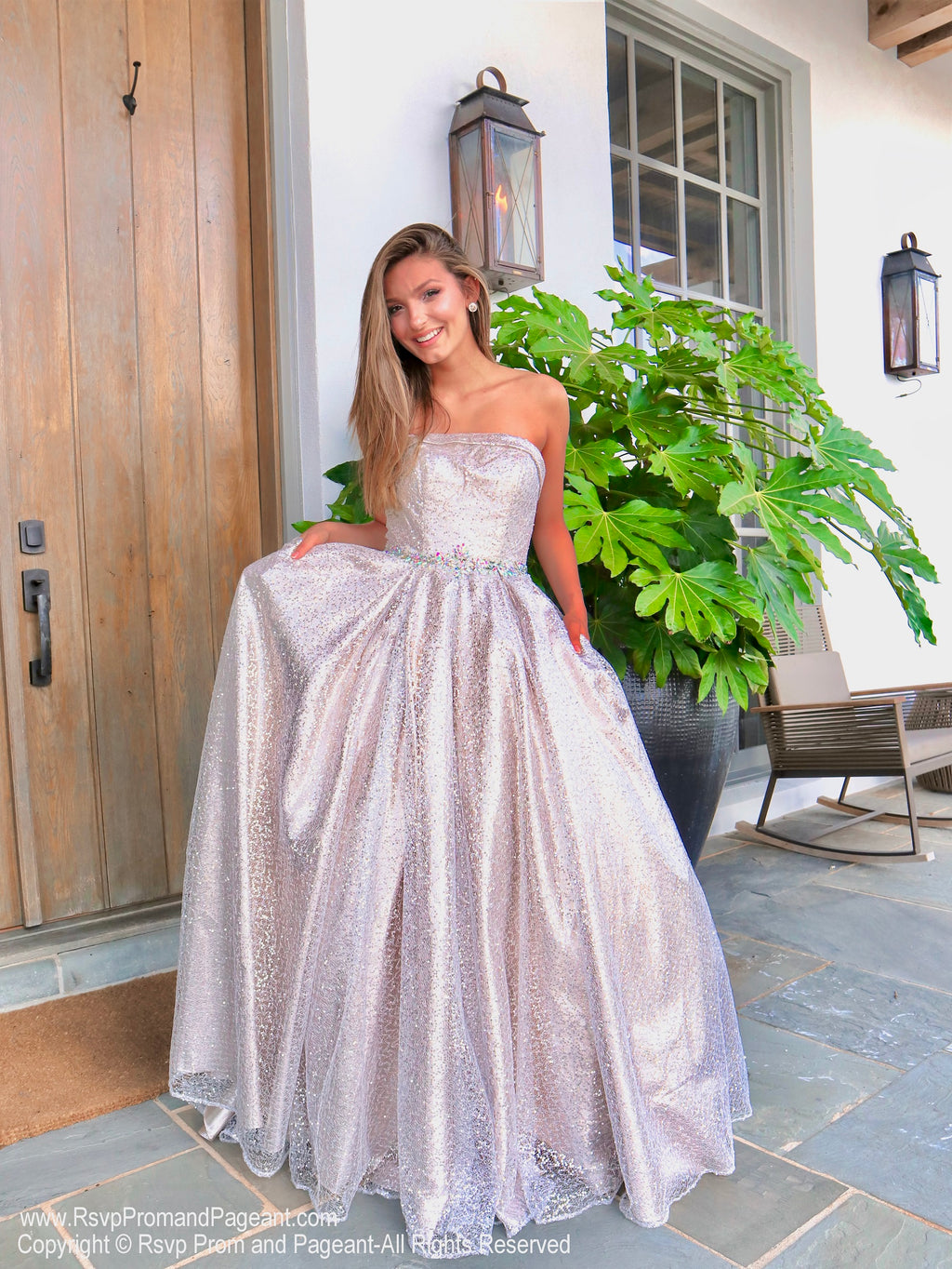 Beautiful model in a Iridescent Shimmering Sequin Ball Gown at Rsvp Prom and Pageant, the most visited prom dress store located in Atlanta, Georgia and also known as Promheaven