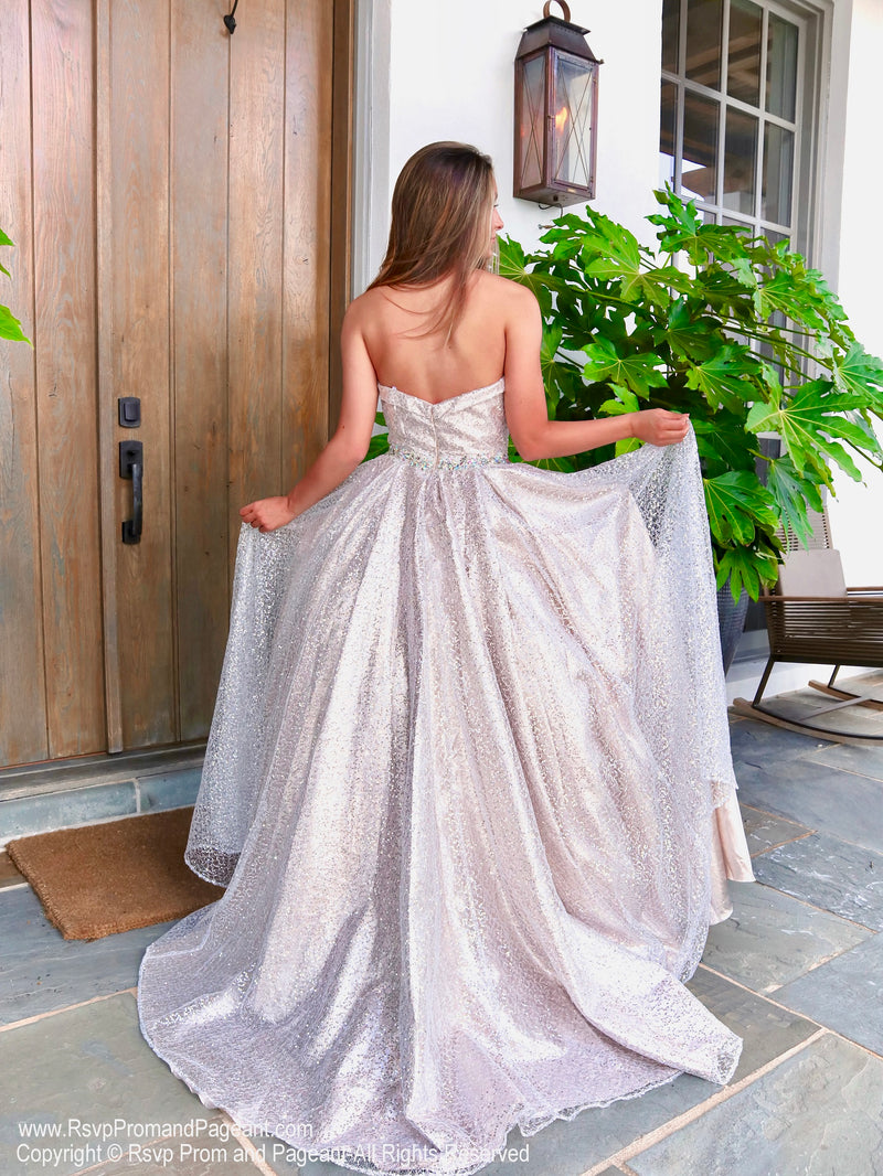 Back of model  in a Iridescent Shimmering Sequin Ball Gown at Rsvp Prom and Pageant, the most visited prom dress store located in Atlanta, Georgia and also known as Promheaven