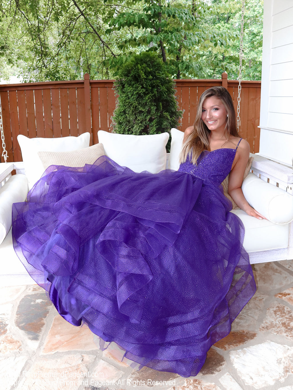 Model sitting this stunning and unique purple ball gown with sparkling embellishments all over and a lace-up back for easy up or downsizing. And its available at RSVP Prom and Pageant, your source for the HOTTEST Prom and Pageant Dresses and exclusive evening gowns and located in Atlanta, Georgia!