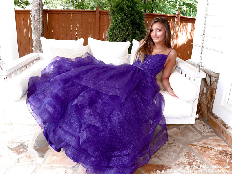 Brunette in this stunning and unique purple ball gown with sparkling embellishments all over and a lace-up back for easy up or downsizing. And its available at RSVP Prom and Pageant, your source for the HOTTEST Prom and Pageant Dresses and exclusive evening gowns and located in Atlanta, Georgia!