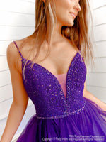 Closeup of model this stunning and unique purple ball gown with sparkling embellishments all over and a lace-up back for easy up or downsizing. And its available at RSVP Prom and Pageant, your source for the HOTTEST Prom and Pageant Dresses and exclusive evening gowns and located in Atlanta, Georgia!
