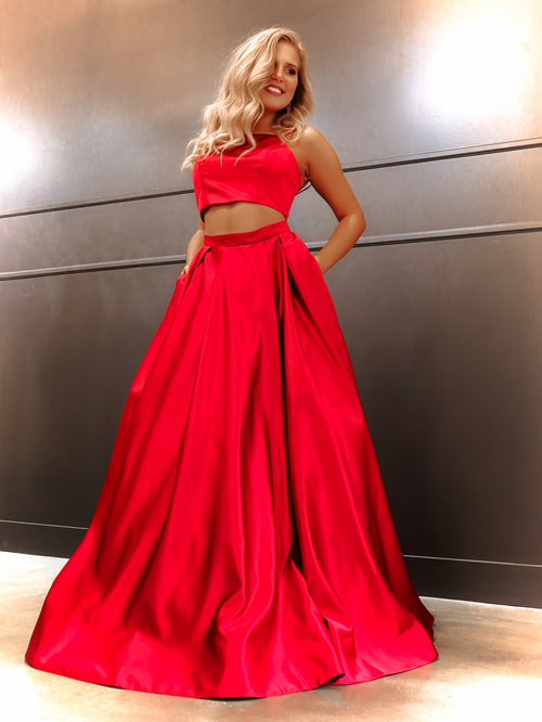 Model in this simple and elegant two piece ball gown featuring a high neckline, spaghetti straps and POCKETS! And it's at Rsvp Prom and Pageant, your source for the HOTTEST Prom and Pageant Dresses and Exclusive Evening Gowns and located in Atlanta, Georgia!