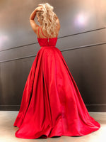 Back of Model in this simple and elegant two piece ball gown featuring a high neckline, spaghetti straps and POCKETS! And it's at Rsvp Prom and Pageant, your source for the HOTTEST Prom and Pageant Dresses and Exclusive Evening Gowns and located in Atlanta, Georgia!