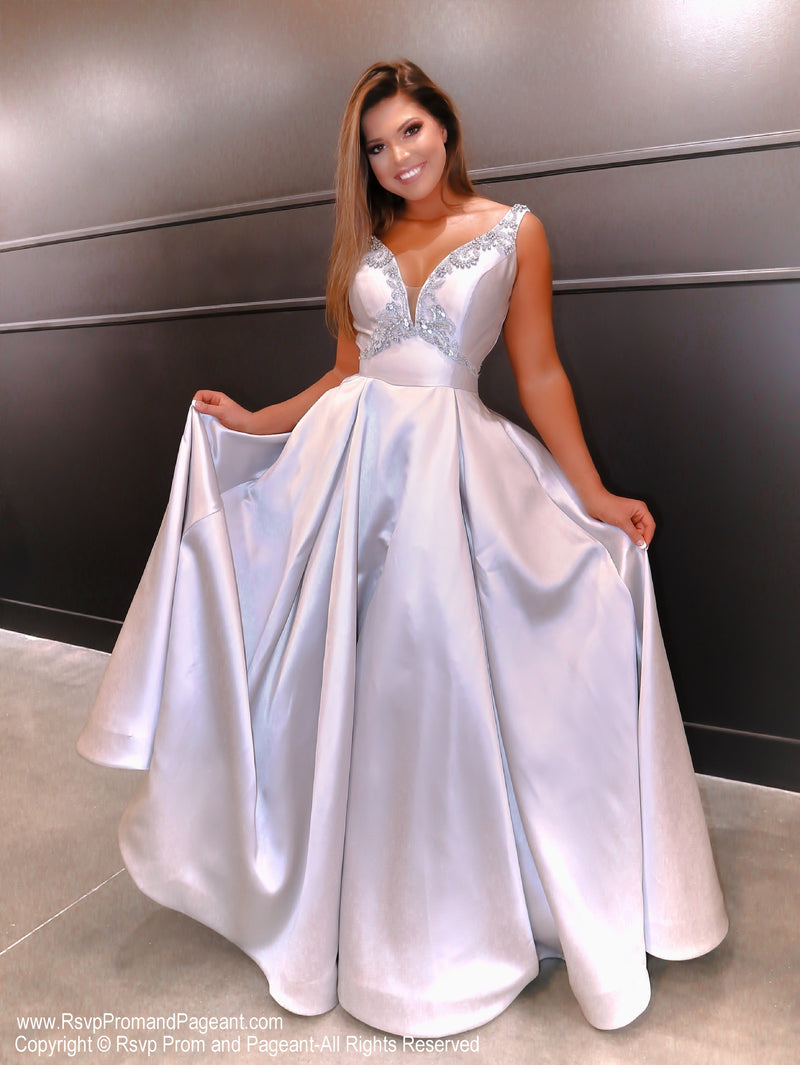 Model in this super elegant silver ball gown! And it's at Rsvp Prom and Pageant, your source for the HOTTEST Prom and Pageant Dresses and exclusive evening gowns and located in Atlanta, Georgia!