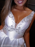 Closeup of model in this super elegant silver ball gown! And it's at Rsvp Prom and Pageant, your source for the HOTTEST Prom and Pageant Dresses and exclusive evening gowns and located in Atlanta, Georgia!