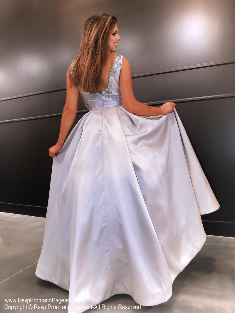 Back of model in this super elegant silver ball gown! And it's at Rsvp Prom and Pageant, your source for the HOTTEST Prom and Pageant Dresses and exclusive evening gowns and located in Atlanta, Georgia!