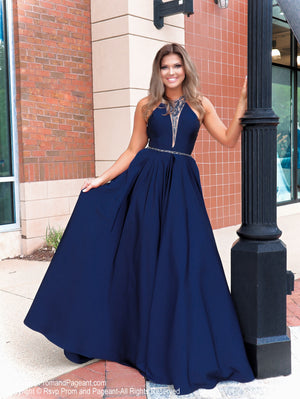 Model in a magnificent navy ball gown featuring a high neckline and beautifully detailed beading on the back! And it's at Rsvp Prom and Pageant, your source for the HOTTEST Prom and Pageant Dresses and Exclusive Evening Gowns and located in Atlanta  Georgia!