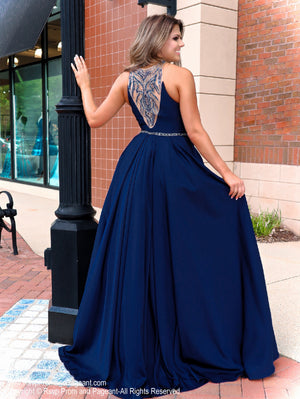 Back of model in a magnificent navy ball gown featuring a high neckline and beautifully detailed beading on the back! And it's at Rsvp Prom and Pageant, your source for the HOTTEST Prom and Pageant Dresses and Exclusive Evening Gowns and located in Atlanta  Georgia!