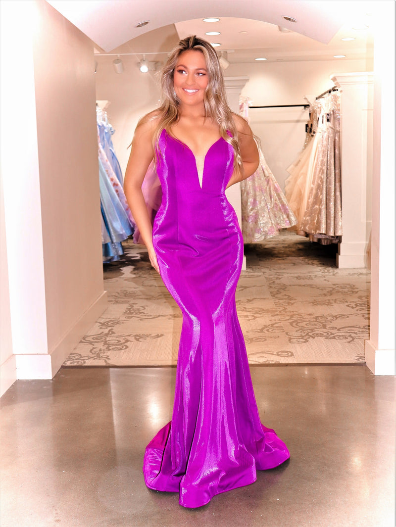 Model in this stunning gown featuring a low cut strappy back and a v neckline! And it's at Rsvp Prom and Pageant, your source for the HOTTEST Prom and Pageant Dresses and Exclusive Evening Gowns and located in Atlanta, Georgia!