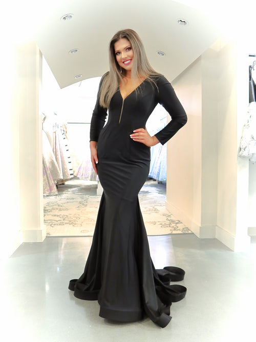 Sexy model in this sexy but elegant mermaid dress that features long sleeves and a long train! And it's at Rsvp Prom and Pageant, your source for the HOTTEST Prom and Pageant Dresses and Exclusive Evening Gowns located in Atlanta, Georgia!