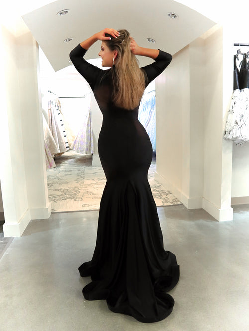 Back of model in this sexy but elegant mermaid dress that features long sleeves and a long train! And it's at Rsvp Prom and Pageant, your source for the HOTTEST Prom and Pageant Dresses and Exclusive Evening Gowns located in Atlanta, Georgia!