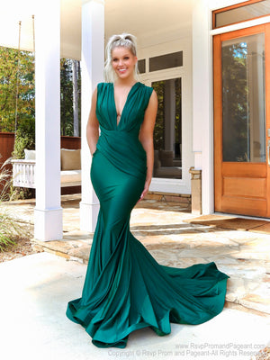 Blonde model in this stunning plunging neck-line, fit and flare, Hunter Prom Dress! And its at RSVP Prom and Pageant, your source for the HOTTEST Prom and Pageant Dresses, located in Atlanta, Georgia!