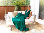 Model sitting on swing in this stunning plunging neck-line, fit and flare, Hunter Prom Dress! And its at RSVP Prom and Pageant, your source for the HOTTEST Prom and Pageant Dresses, located in Atlanta, Georgia!