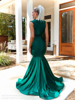 Back of model in this stunning plunging neck-line, fit and flare, Hunter Prom Dress! And its at RSVP Prom and Pageant, your source for the HOTTEST Prom and Pageant Dresses, located in Atlanta, Georgia!