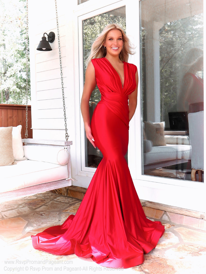 Model in a jawdropping red gown with Its fitted silhouette and a sexy plunging neckline it will for sure be a show-stopper at your Prom! And its at RSVP Prom and Pageant, your source for the HOTTEST Prom and Pageant Dresses and exclusive evening gowns and located in Atlanta, Georgia!