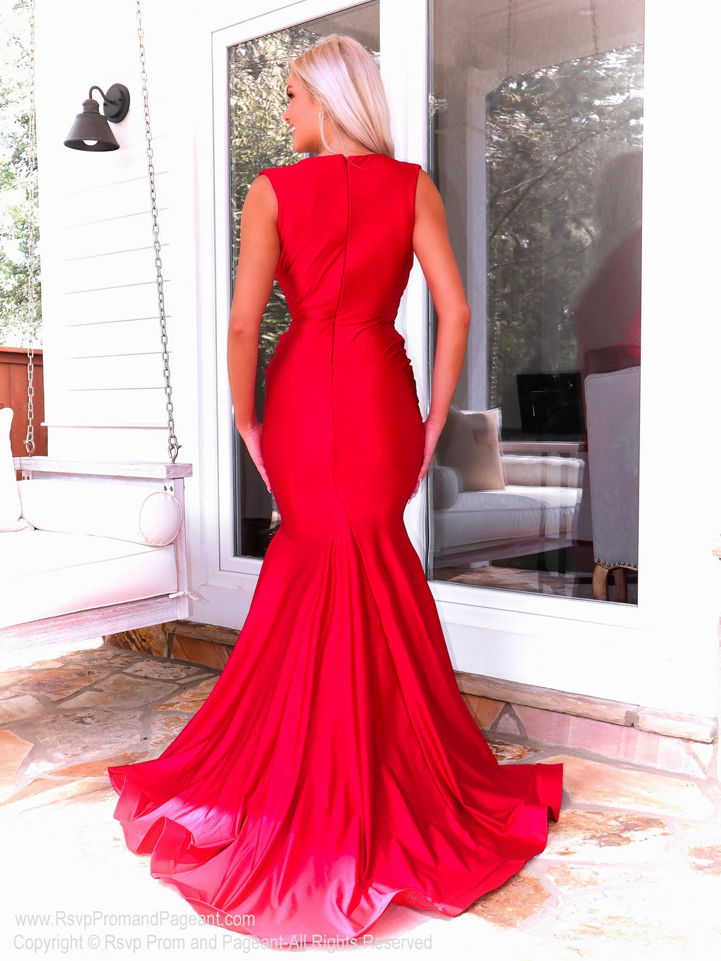 Back of Model in a jawdropping red gown with Its fitted silhouette and a sexy plunging neckline it will for sure be a show-stopper at your Prom! And its at RSVP Prom and Pageant, your source for the HOTTEST Prom and Pageant Dresses and exclusive evening gowns and located in Atlanta, Georgia!
