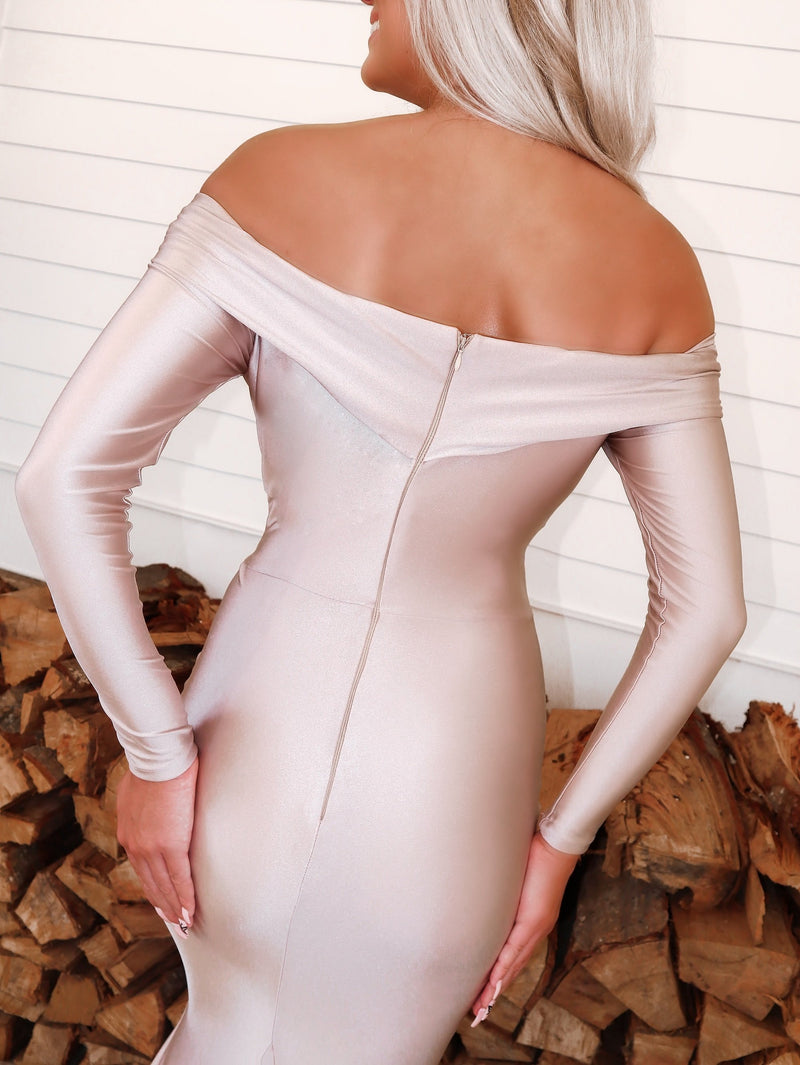 Closeup of back of Beautiful model in this STUNNING Blush, long sleeve, off the shoulder, fit and flare Prom dress or evening gown! And its at RSVP Prom and Pageant, your source for the HOTTEST Prom and Pageant Dresses and exclusive evening gowns and located in Atlanta, Georgia!