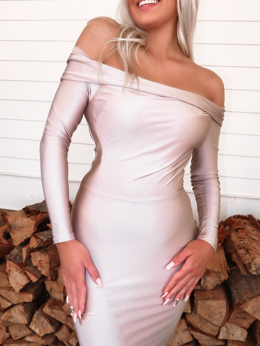 Closeup of Beautiful model in this STUNNING Blush, long sleeve, off the shoulder, fit and flare Prom dress or evening gown! And its at RSVP Prom and Pageant, your source for the HOTTEST Prom and Pageant Dresses and exclusive evening gowns and located in Atlanta, Georgia!