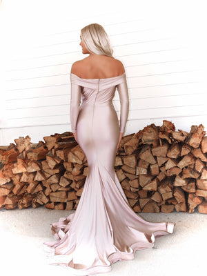 Back of Beautiful model in this STUNNING Blush, long sleeve, off the shoulder, fit and flare Prom dress or evening gown! And its at RSVP Prom and Pageant, your source for the HOTTEST Prom and Pageant Dresses and exclusive evening gowns and located in Atlanta, Georgia!