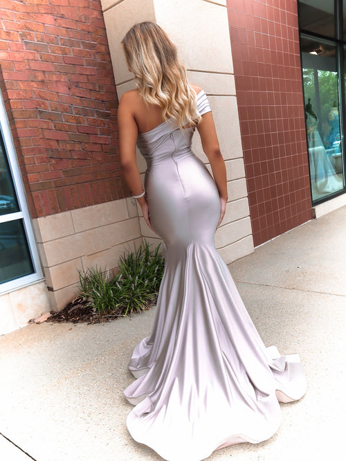 Back of model looking edgy in this sexy, fitted, Blush, one shoulder, fitted Prom Dress with a high slit. And its at RSVP Prom and Pageant, your source for the HOTTEST Prom and Pageant Dresses and exclusive evening gowns and located in Atlanta, Georgia!