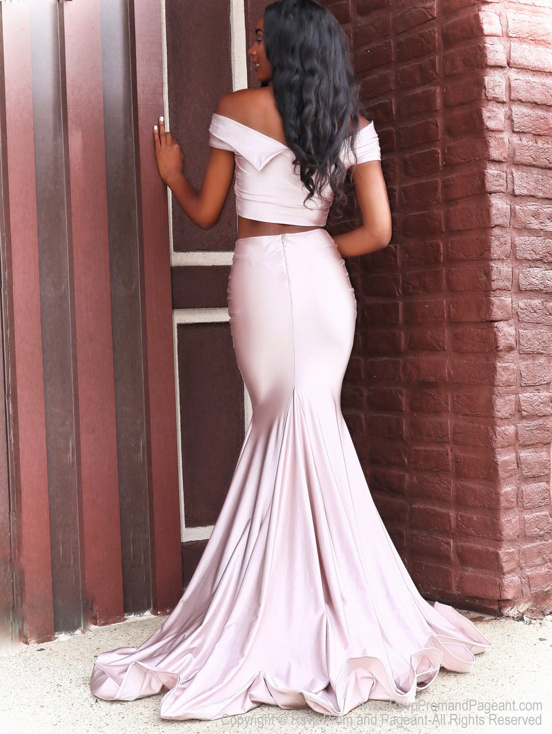 Back of Our Rsvp model is Prom-ready in this super cute Blush off the shoulder, fitted, two-piece, Prom Dress. And it's at RSVP Prom and Pageant, your source for the HOTTEST Prom and Pageant Dresses and Exclusive Evening Gowns and located in Atlanta, Georgia!