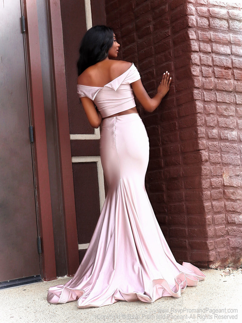 Back of our pretty Our Rsvp model is Prom-ready in this super cute Blush off the shoulder, fitted, two-piece, Prom Dress. And it's at RSVP Prom and Pageant, your source for the HOTTEST Prom and Pageant Dresses and Exclusive Evening Gowns and located in Atlanta, Georgia!