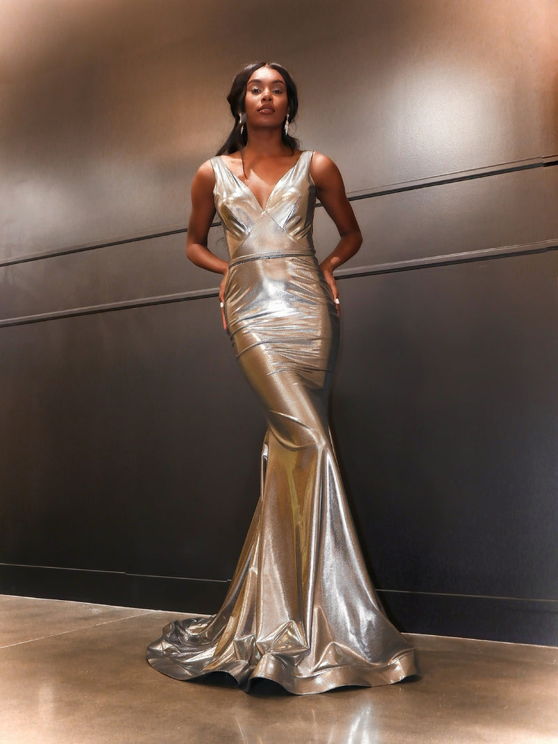 African American model in this sexy Silver fit and flare evening gown!  And its at RSVP Prom and Pageant, your source for the HOTTEST Prom and Pageant Dresses and exclusive evening gowns and located in Atlanta, Georgia.