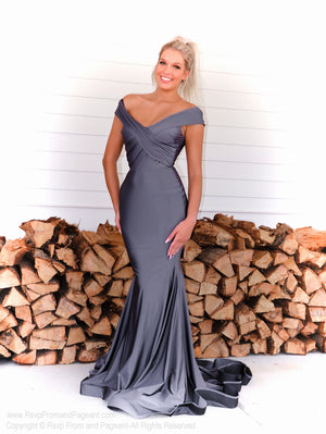 Model turning every head in this fit and flare off the shoulder red evening gown! And it's at Rsvp Prom and Pageant, your source for the HOTTEST prom and pageant dresses and exclusive evening gowns and located in Atlanta Georgia!