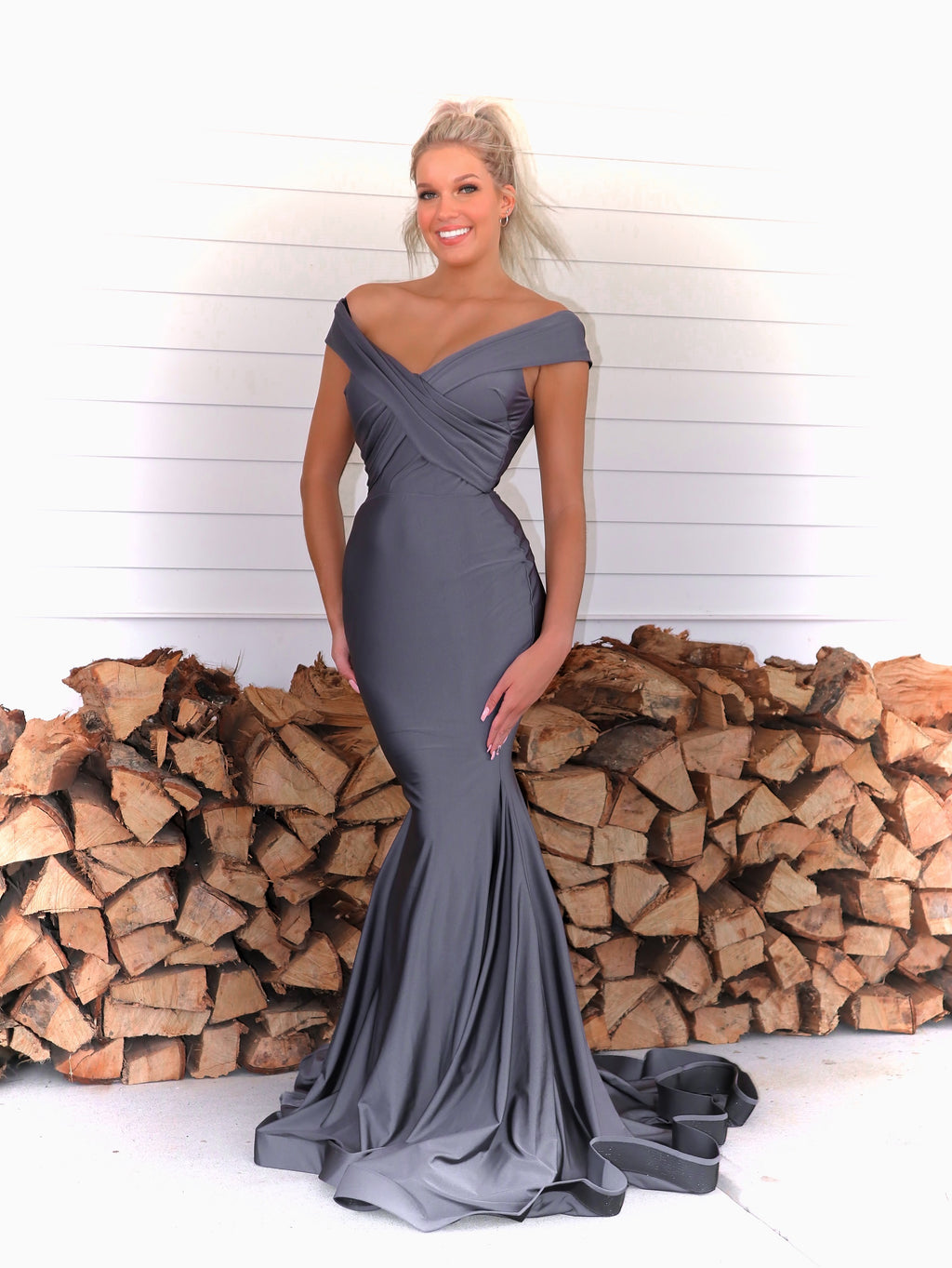 Pretty Model turning every head in this fit and flare off the shoulder red evening gown! And it's at Rsvp Prom and Pageant, your source for the HOTTEST prom and pageant dresses and exclusive evening gowns and located in Atlanta Georgia!